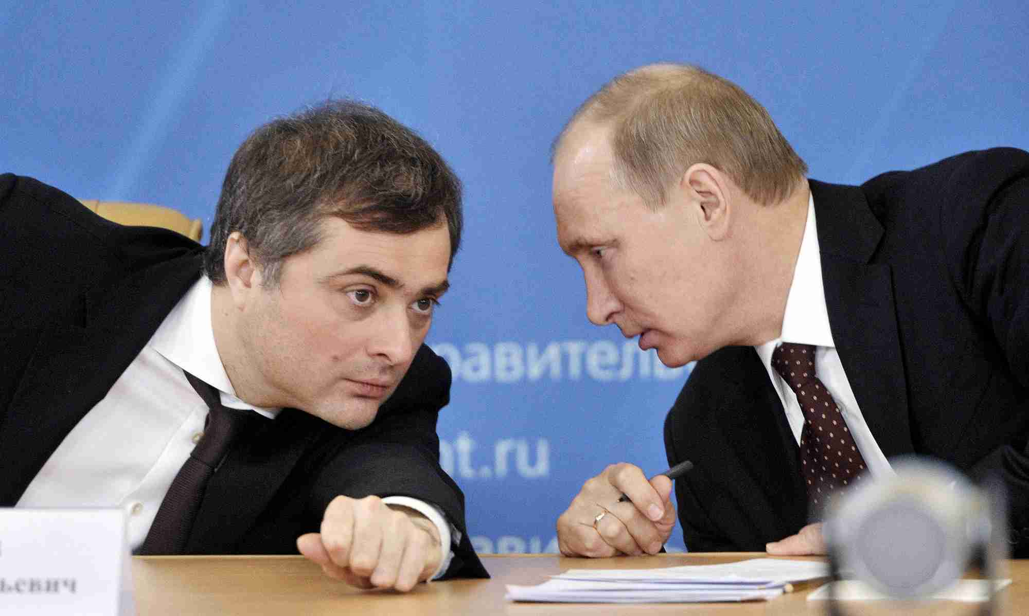 Russian Prime Minister Vladimir Putin (R) talks with Deputy Prime Minister Vladislav Surkov as they attend a meeting on the modernization of regional systems of higher education in the Russian Siberian city of Kurgan in this February 13, 2012 file photo. Surkov, who was once President Putin's chief political strategist and dubbed the Kremlin's puppet master, resigned on May 8, 2013. REUTERS/Alexei Nikolsky/RIA Novosti/Pool/Files (RUSSIA - Tags: EDUCATION POLITICS) THIS IMAGE HAS BEEN SUPPLIED BY A THIRD PARTY. IT IS DISTRIBUTED, EXACTLY AS RECEIVED BY REUTERS, AS A SERVICE TO CLIENTS. FOR EDITORIAL USE ONLY. NOT FOR SALE FOR MARKETING OR ADVERTISING CAMPAIGNS